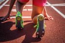 Female on running track.
